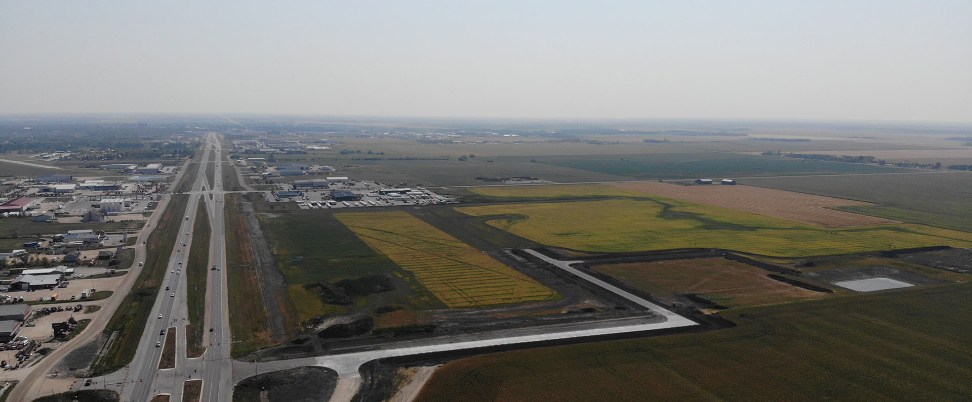 Aerial photo of the Steinbach North Business Park development, with cars driving on Hwy 12N