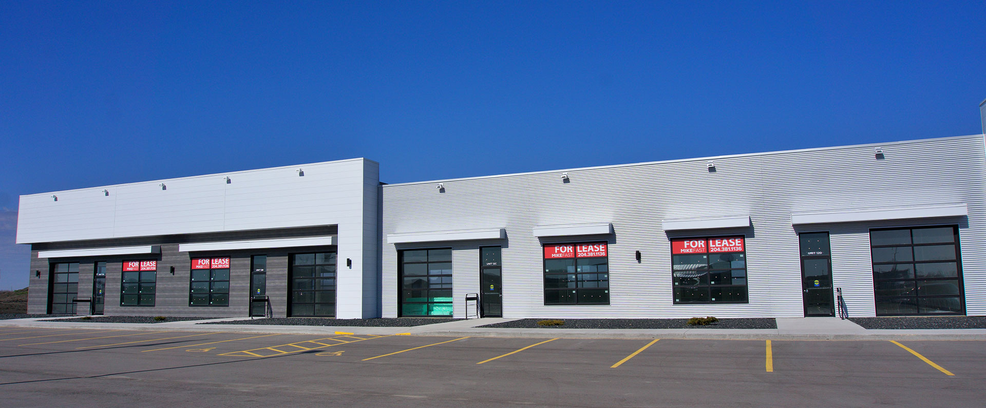An angled photo of the front of a building in the Steinbach North Business Park development, with red